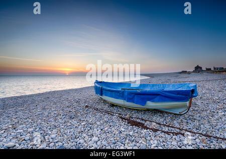 Fishing boat on Chesil Beach in Portland, Dorset - Stock Photo