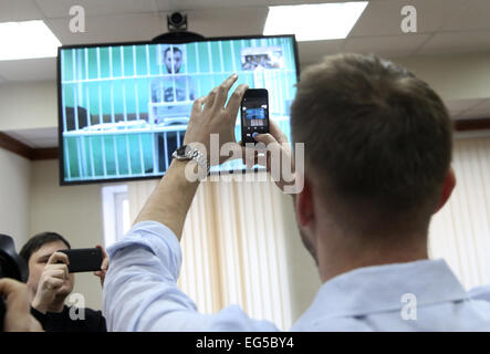 Moscow, Russia. 17th Feb, 2015. Opposition activist Alexei Navalny uses a smartphone to take a picture of the video - Stock Photo