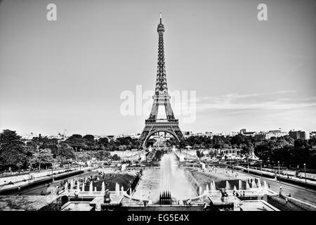 Eiffel Tower seen from fountain at Jardins du Trocadero at a sunny summer day, Paris, France. Black and white - Stock Photo