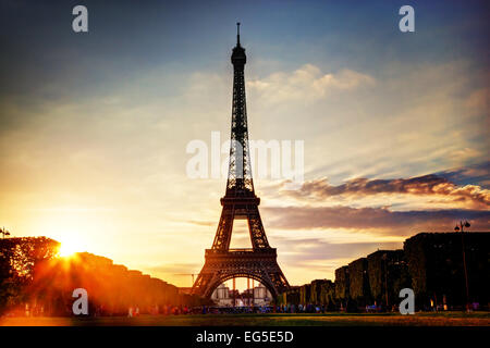 Eiffel Tower seen from Champ de Mars at sunset, Paris, France - Stock Photo