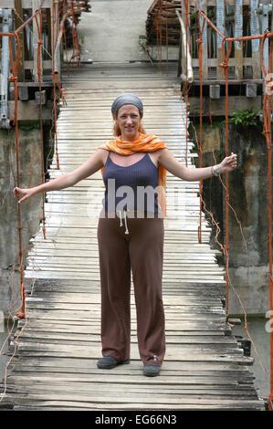 Tourist woman in a Bohol bridge. Philippines Bohol Tigbao Hanging Bridge Loboc River Visayas Stock PhotoPhilippines - Stock Photo