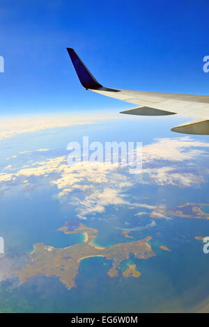 view from the airplane window over the ocean - Stock Photo