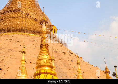The Shwedagon Pagoda with bamboo scaffolding for the 5 yearly relaying of the gold leaf, Yangon, Myanmar ( Burma - Stock Photo