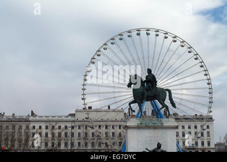 Equestian statue of Louis XIV in Bellecourt, Lyon,France with the panoramic ferris wheel in the background. - Stock Photo