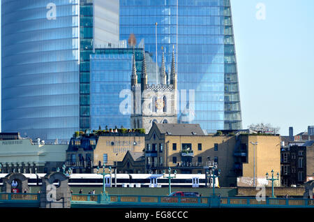 London, England, UK. Tower of Southwark Cathedral in front of The Shard. Train on London Bridge - Stock Photo