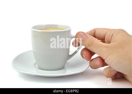 Hand and a cup of coffee on bright backgroud - Stock Photo