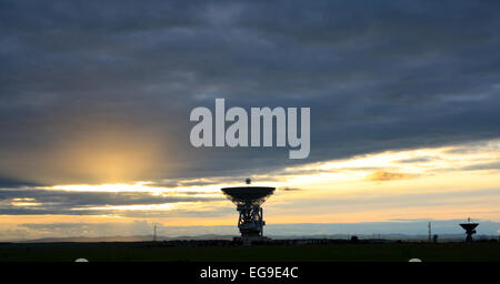 Locator of an outer-space communication against a sunset. - Stock Photo