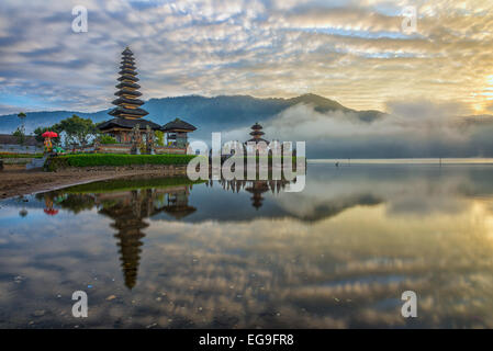 Indonesia, Bali, Pura Ulun Danu Bratan, Reflection of pura temple at sunrise - Stock Photo