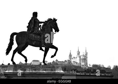 Equestrian statue of Louis XIV and the Basilica of Notre Dame de Fourviere on a background from Place Bellecour, - Stock Photo