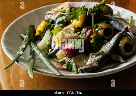 fish salad with olives and onion - Stock Photo