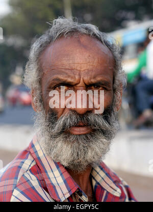 Closeup portrait of Indian old street vendor on January 6,2012 In Hyderabad,India - Stock Photo