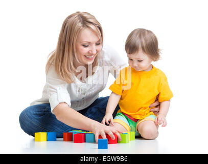 mother and baby play with building blocks toy isolated on white - Stock Photo