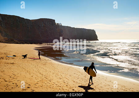 Surfer on the beach in the sunshine day. Portugal - Stock Photo