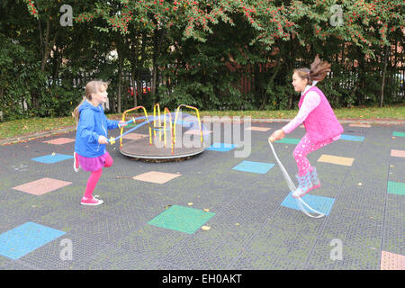 Girls playing in urban park - model released - Stockfoto