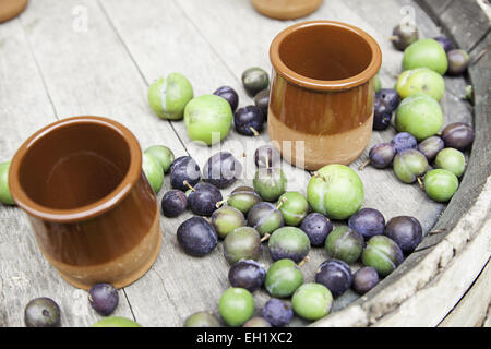 Ripe plums, detail of a fruit on a table, food healthy lifestyle - Stock Photo