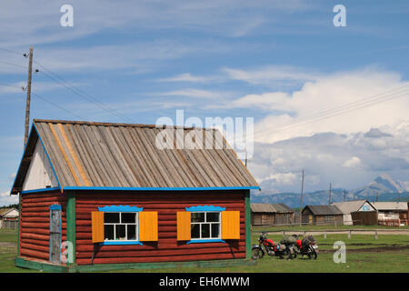 Village In The Taiga with colorful house and motorcycles - Stock Photo