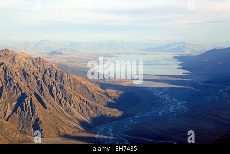 Aerial View of Tasman Glacier River to Lake Pukaki from Helicopter Mount Cook National Park New Zealand - Stock Photo