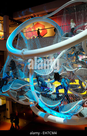 Infinity Climber a suspended multi-story play space for children and adults hanging over Atrium floor of Liberty - Stock Photo