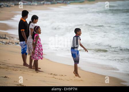 Family on a beach, Arugam Bay, Sri Lanka, Asia - Stock Photo