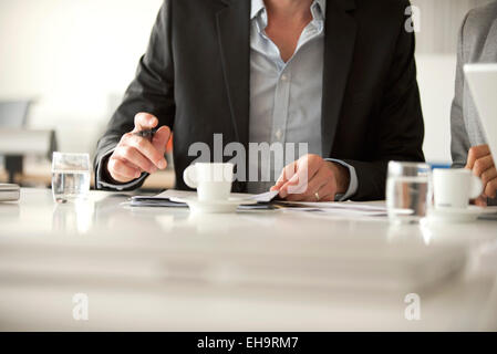 Executives in meeting, cropped - Stock Photo