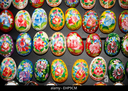 Hand Crafted Wooden Easter Eggs On Black Background. Hand Painted Easter Eggs Decoration of Various Colors - Stock Photo