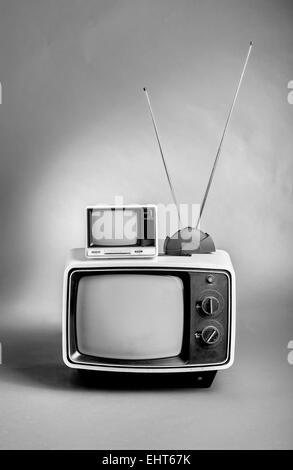 Retro 60's TVs in black and white. - Stock Photo