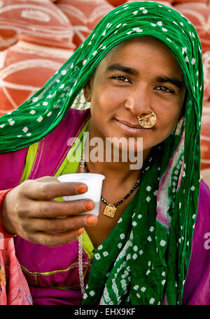 A image of a rural lady (potter's wife) taking her tea in the morning. - Stock Photo