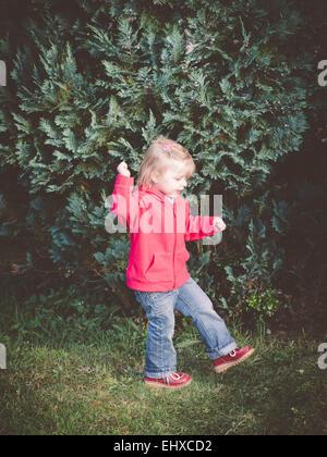 Dancing girl in garden - Stock Photo