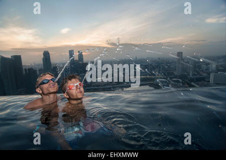 Teenage boys having fun at the pool, Marina Bay Sands, Singapore City, Singapore - Stock Photo