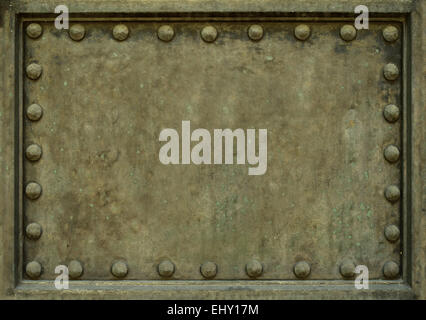 Background Texture Of Heavy Protective Metal Plate With Rivets - Stock Photo