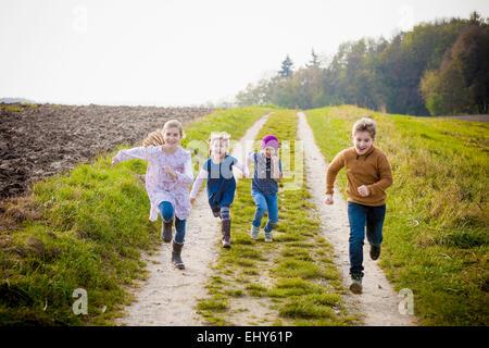 Children running on path - Stock Photo