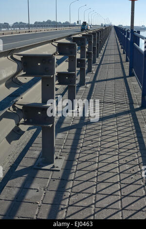 Double rail guards on the bridge road - Stock Photo