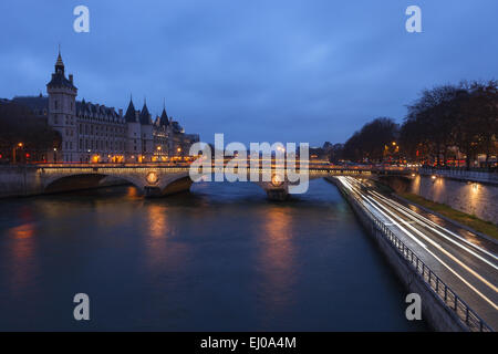View of the Seine River by twilight from Pont Notre Dame, with the Conciergerie in the background. Paris, Ile de - Stock Photo