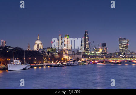 DUSK THAMES City of London lights and River Thames viewed from Waterloo Bridge at clear sunset dusk London UK - Stock Photo