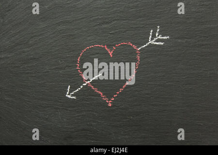 Chalk heart with arrow drawn on a chalk board.. - Stockfoto