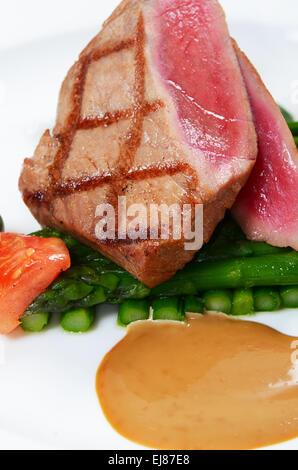 Tuna a grill with an asparagus - Stock Photo