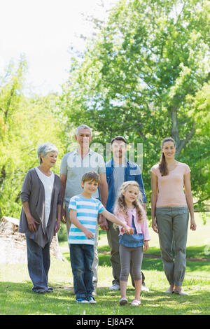Happy extended family walking in park - Stockfoto
