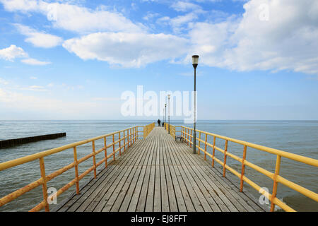 Old wooden pier over the sea - Stock Photo