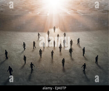 Tiny people walking out of a mysterious maze - Stock Photo