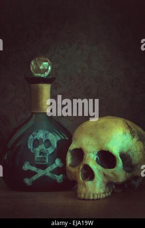 Skull with poison bottle - Stock Photo