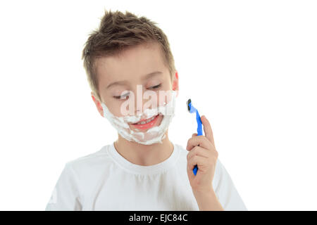 playful little young boy shaving face over white - Stock Photo
