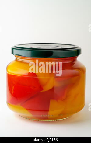 Glass jar of preserved peppers close-up - Stock Photo