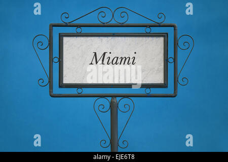 Miami on a Signboard. Light Blue Background. - Stock Photo