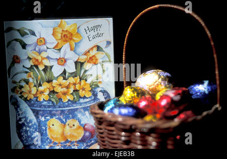 Easter greeting card and basket of eggs - Stock Photo