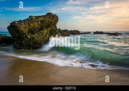 Rocks and waves in the Pacific Ocean at sunset, at Thousand Steps Beach, in Laguna Beach, California. - Stock Photo