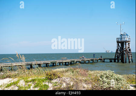 Walking and fishing pier along the shoreline on dauphin for Dauphin island fishing pier