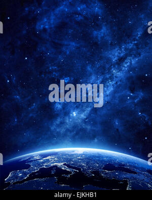 Earth at night as seen from space with blue, glowing atmosphere and space at the top. Perfect for illustrations. - Stock Photo