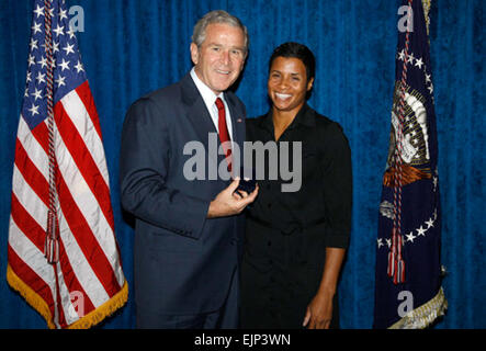 President George W. Bush stands with Keela Carr, a 35-year-old fitness and athletic trainer from Orlando, shortly - Stock Photo