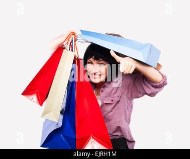happy young woman covered in shoping bags - Stock Photo
