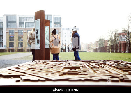 Teenage Girls Visiting the Berlin Wall Memorial, Bernauer Strasse, Berlin, Germany - Stock Photo